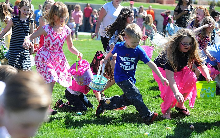 It didn't take the 8- to 10-year-olds long to clean the lawn of eggs at the annual Prescott Valley Easter Egg Hunt. (Les Stukenberg/Tribune, file)