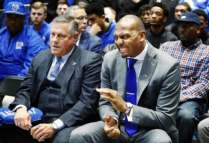 University of Memphis athletic director Tom Bowen, left, and new Memphis men's basketball coach Penny Hardaway, attend a news conference introducing Hardaway Tuesday, March 20, 2018, at the Laurie-Walton Family Basketball Center in Memphis, Tenn. (Mark Weber/The Commercial Appeal, via AP)