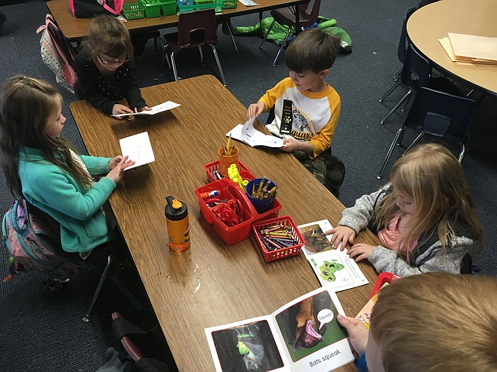 From left, Luke Jentzen, Paisley Creager and Aiden Meadows read in Mrs. Murphy's Kindergarten class at Abia Judd.