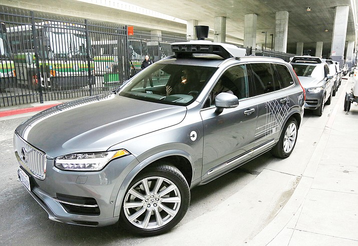 In this Dec. 13, 2016 file photo, an Uber driverless car heads out for a test drive in San Francisco. Police in a Phoenix suburb say one of Uber's self-driving vehicles has struck and killed a pedestrian. (AP Photo/Eric Risberg,File)