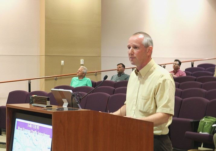 Greg Henry, city engineer, gives background information at Tuesday's Council meeting on the three proposed interchanges in Kingman.
