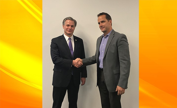 Cottonwood Police Chief Steve Gesell shook Federal Bureau of Information Director Christopher Wray's hand lin Phoenix, after a meeting between the director and approximately 30 police chiefs from around the state.