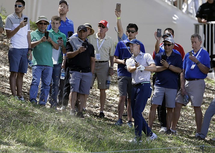 Jordan Spieth hits out of the rough on the 16th hole during round-robin play at the Dell Technologies Match Play golf tournament Wednesday, March 21, 2018, in Austin, Texas. (AP Photo/Eric Gay)