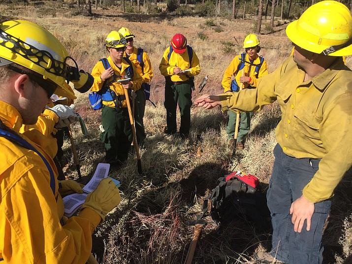 Wildland-firefighting students receive hands-on training during the Arizona Wildfire and Incident Management Academy field day Wednesday, March 14, 2018 in Prescott. Daily Courier Reporter Max Efrein joined them by taking the S-130/S-190 course. (Max Efrein/Courier)