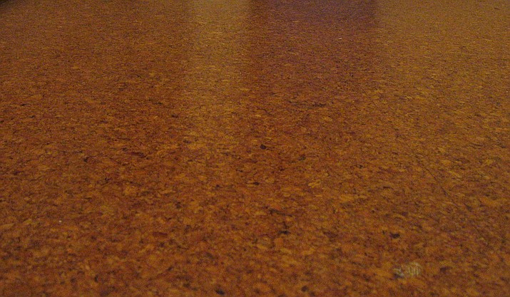 This photo from 2006 shows varnished cork tiles installed on a bathroom floor. Sandy Griffis prefers cork flooring because it is comfortable to stand on, environmentally sustainable, won't hold onto dust and pollen and resists bacteria and fungi. (Photographed by Mike1024/WikiMedia)
