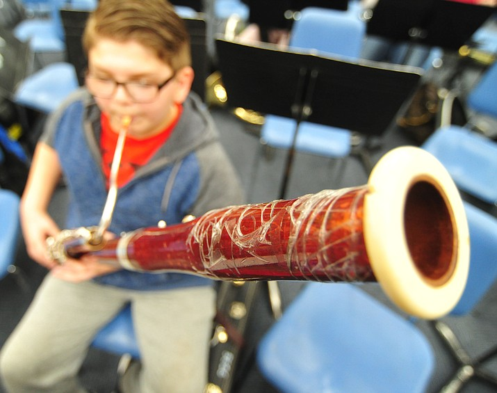 Joseph Cutaia plays a taped up bassoon at Granite Mountain School in Prescott. (Les Stukenberg/Courier)