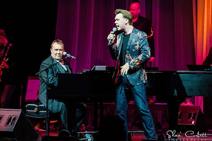 "Terry (seated at the piano) and Nick Davies have performed their ""Piano Men: Generations"" show, celebrating the music of Billy Joel and Elton John, across 37 countries (Terry Davies/Courtesy)."