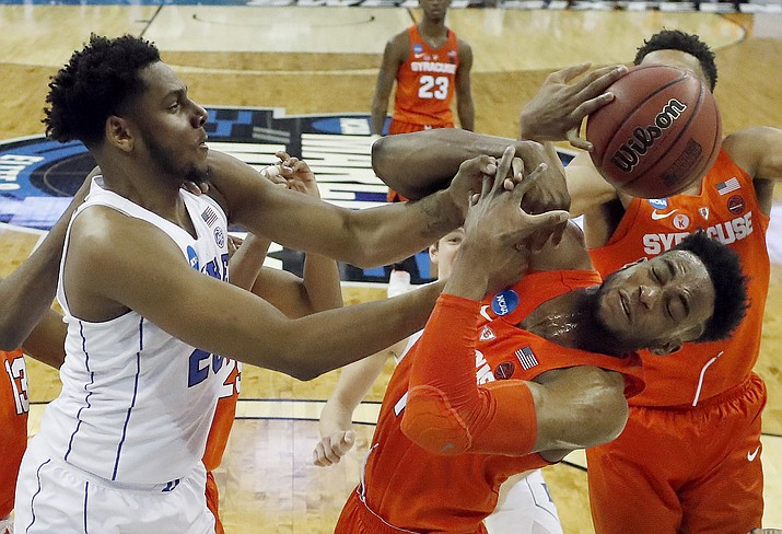 Syracuse's Oshae Brissett, right, and Duke's Marques Bolden reach for a rebound during the first half of a regional semifinal game in the NCAA men's college basketball tournament Friday, March 23, 2018, in Omaha, Neb. (AP Photo/Nati Harnik)