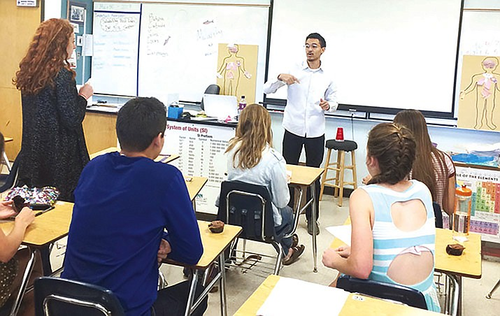 In this May 2017 Courier file photo, Prescott High School chemistry teacher Todd Harris Jr. speaks to his students. Th state House and Senate agreed Thursday to extend for another 20 years the 0.6-cent sales tax first approved by voters in 2000 for the state's education sales tax — and the teacher salaries it supports. Without that action, the levy would self-destruct on June 30, 2021, taking with it the more than $670 million a year it now raises — $384 million of what's collected is specifically earmarked for teacher salaries. (Nanci Hutson/Courier)