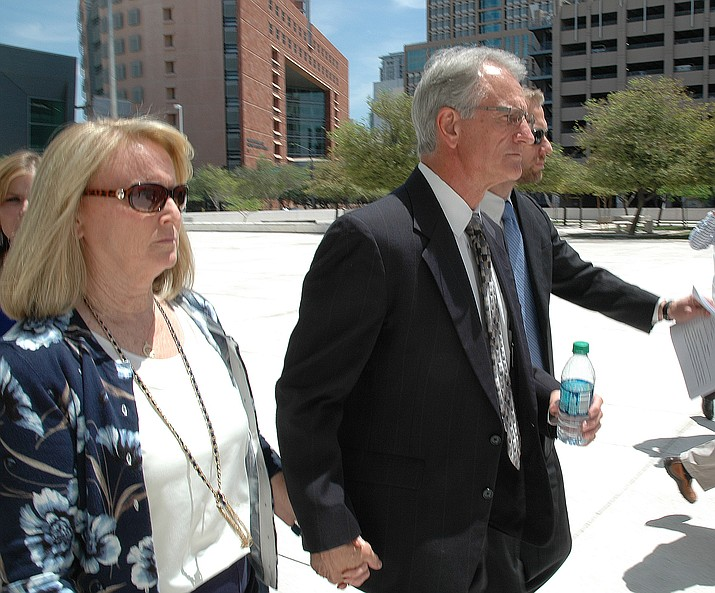Former utility regulator Gary Pierce and wife, Sherry, leave federal court last year after pleading innocent to charges of bribery, conspiracy and fraud. (Capitol Media Services file photo by Howard Fischer)