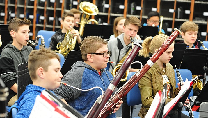 A taped up basoon, dented and broken French Horns, an old tuba that can't be repaired anymore and an oboe that's out for a second time being repaired are just some of the hurdles facing some of the 153 band students at Granite Mountain  School in Prescott Friday morning. (Les Stukenberg/Courier)