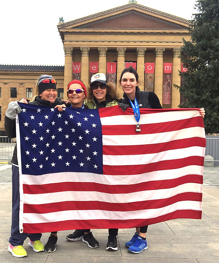 From left, Anna Shuffler, Shirley Bowers, Marlys Morton and Nadine Morton pose together after Bowers finished her final half marathon in Philadelphia. Not pictured: Pat Auer and Patty Pane.