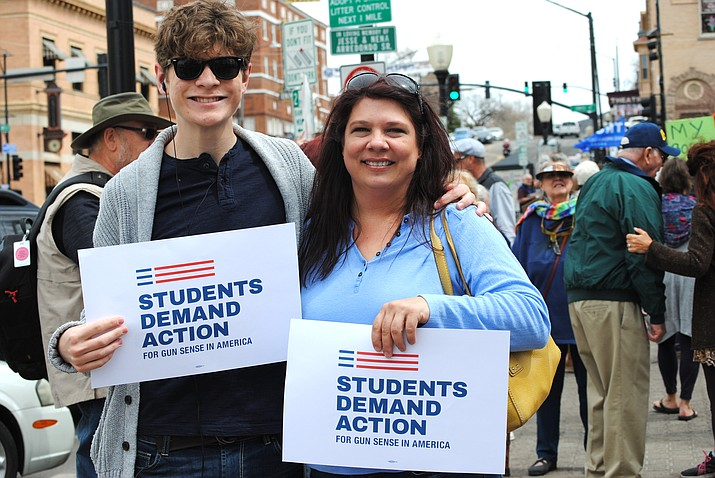 Prescott High School 18-year-old senior Jonathan Palmer and his mother Amy Palmer participate in March For Our Lives on Saturday, March 24, 2018, in downtown Prescott. More than 1,500 marched Saturday to bring awareness to changes in gun safety. Prescott Indivisible, Yavapai Democrats, Democratic Women of Prescott and MadShirtz put the rally together. (Courtesy photo submitted by Bonnie Dann)