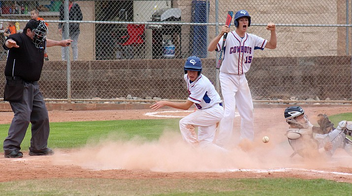 Camp Verde freshman Mason Rayburn scores on a delayed double steal as junior Braden Schuh cheers during the Cowboys' 12-5 loss to Scottsdale Prep at home on Thursday. (VVN/James Kelley)