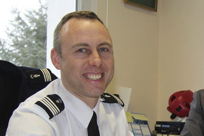 In this image dated March 2013 and provided by regional newspaper Ouest France, Arnaud Beltrame poses for a photo in Avranches, western France. The officer who offered to be swapped for a female hostage was identified as Col. Arnaud Beltrame. He managed to surreptitiously leave his phone on so that police outside could hear what was going on inside the supermarket — and crucially, decide when to storm it. (Ouest France)