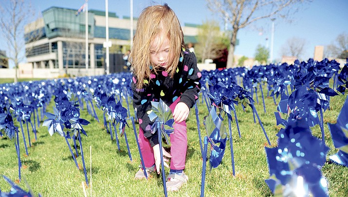 Maia Sampson adjusts a pinwheel at the Prescott Valley Civic Center on April 1, 2016. Prescott Valley is set to celebrate safe childhood with another pinwheel party Saturday, April 21, 2018, at the Civic Center. (Les Stukenberg/Courier, File)