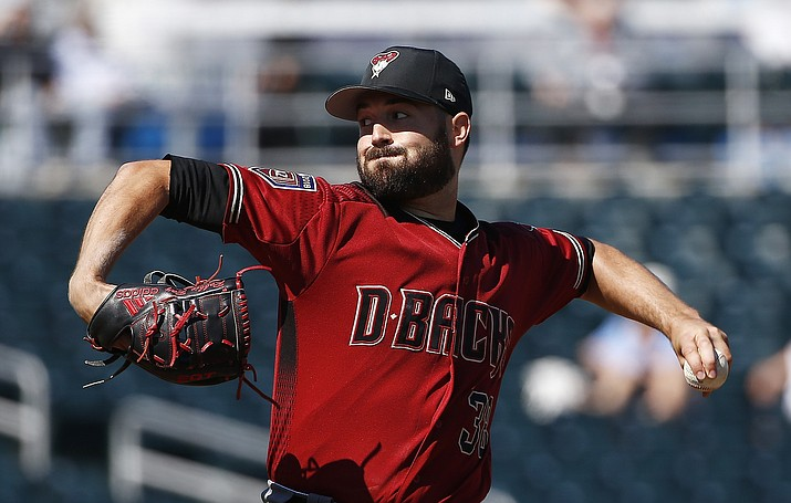 In this Feb. 26, 2018, file photo, Arizona Diamondbacks pitcher Robbie Ray throws against the Cincinnati Reds during the first inning of a spring training baseball game in Goodyear. The Diamondbacks were one of baseball's big surprises a year ago. The surprise this year would be if they don't keep winning. (Ross D. Franklin/AP, File)