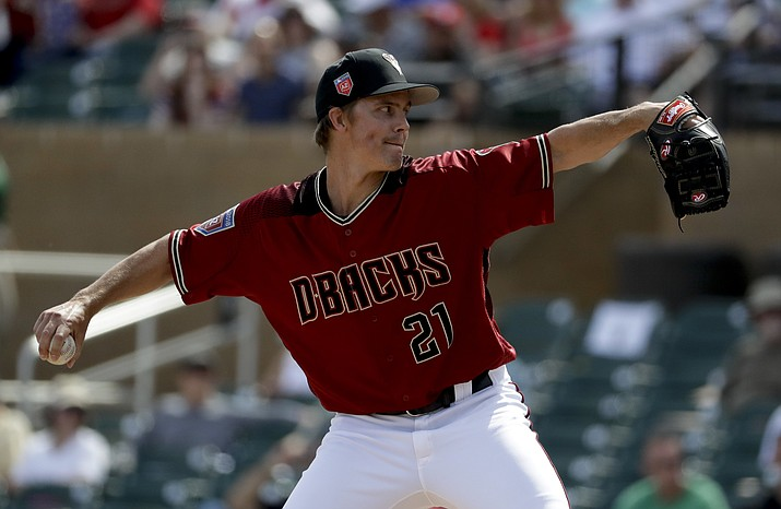 Arizona Diamondbacks starting pitcher Zack Greinke throws in a spring training game March 14, 2018, in Scottsdale. The Arizona ace pitched one-hit ball over six innings in the Diamondbacks' 7-0 exhibition victory over the Cleveland Indians on Monday, March 26, 2018, in Phoenix. (Chris Carlson/AP, File)