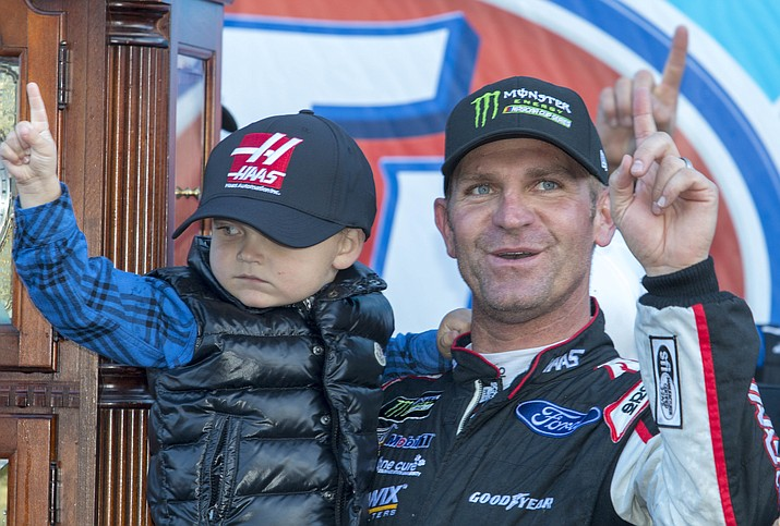 Clint Bowyer, right, celebrates after winning a NASCAR Cup Series auto race at Martinsville Speedway in Martinsville, Va., Monday, March 26, 2018. (Matt Bell/AP)