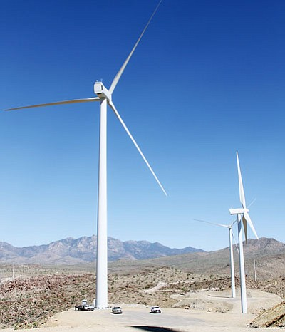 Three wind turbines dot the landscape at the Western Wind Energy Project outside Kingman. (Daily Miner File Photo)