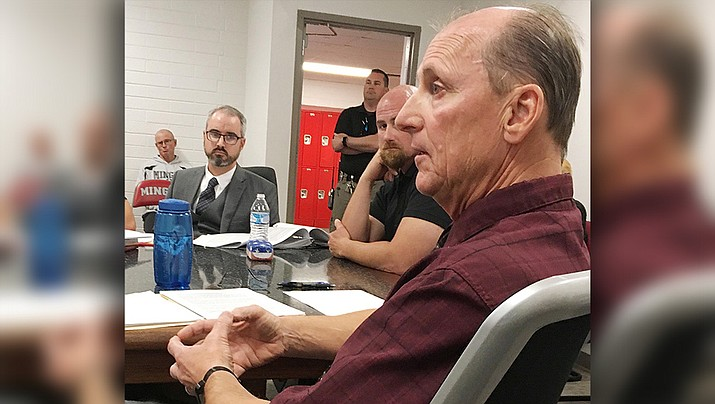 In a disciplinary hearing Monday, Mingus Union High School Assistant Principal Allen Mitchell speaks to members of the Mingus Union school board. (Photo by Bill Helm)