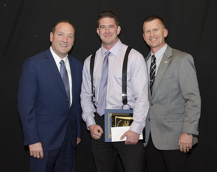 Police Officer of the Year Matt Hepperle is flanked by Police Chief Bryan Jarrell, left, and Deputy Chief James Edelstein. (Courtesy)