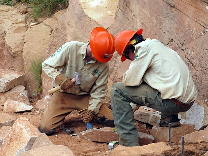 Workers in this 2010 file photo work on a multimillion-dollar project to rehabilitate the South Kaibab Trail at Grand Canyon National Park. The park has almost $330 million in deferred maintenance, the government says. (Photo/ Michael Quinn, NPS and Creative Commons)