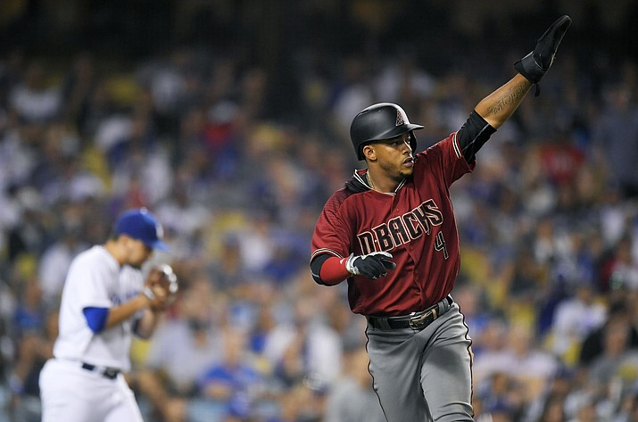 In this Wednesday, Sept. 6, 2017, file photo, Arizona Diamondbacks' Ketel Marte, right, gestures toward second after scoring on a double by Adam Rosales as Los Angeles Dodgers relief pitcher Luis Avilan walks back to the mound during the seventh inning of a baseball game, in Los Angeles. On Monday, March 26, 2018, a person familiar with the deal says the Arizona Diamondbacks and infielder Marte have agreed to a $24 million, five-year contract. (Mark J. Terrill/AP, File)