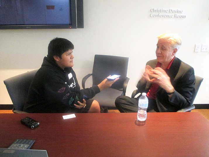 Hopi High's Ty Lilly interviews ASU's Dean of Communication Christopher Callahan during a recent visit to the campus. (Stan Bindell/NHO)