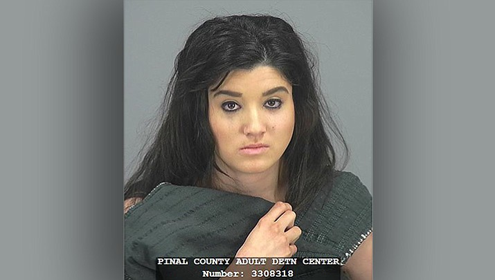 This undated photo provided by the Pinal County Sheriff's office shows Brittany Velasquez. Authorities said Tuesday, March 27, 2018, that Velasquez has been arrested on suspicion of first-degree murder after her two children were found in car seats in a vehicle amid evidence of foul play. (Pinal County Sheriff's Office)