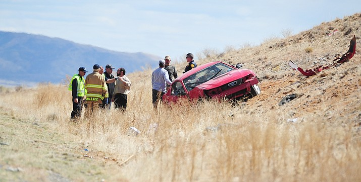 Emergency personnel at the scene of a rollover accident on Highway 89A. (Les Stukenberg/The Daily Courier)