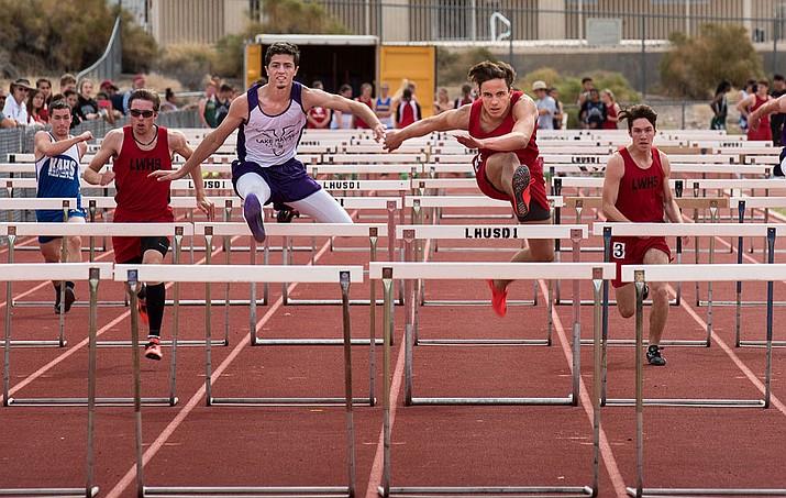 From left, Lee Williams' Zack Tempert, Enzo Marino T.J. Cobanovich run the 110-meter hurdles at the Rotary Invite in Lake Havasu.