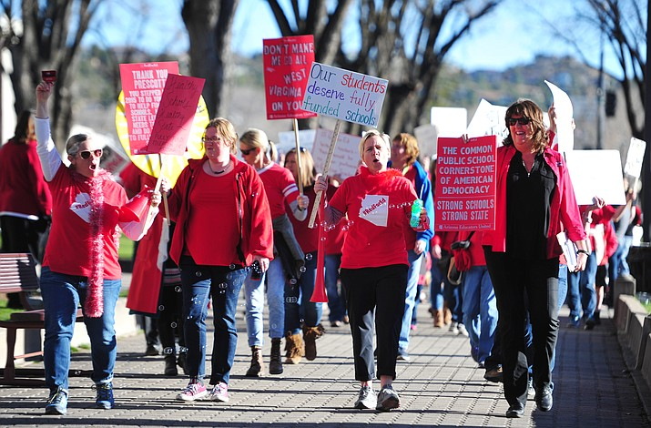 Hundreds of local teachers, students, family members and supporters march around the Yavapai County Courthouse Plaza Wednesday, March 28, 2018, as they seek more competitive pay and better benefits for educators in Yavapai County and Arizona. (Les Stukenberg/Courier)