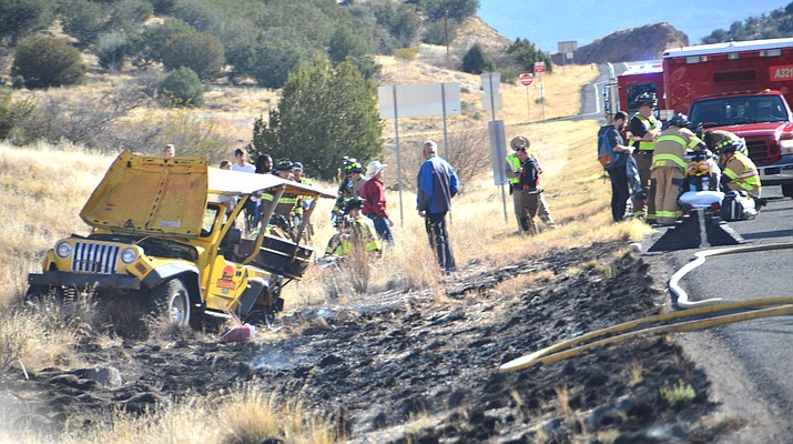 "A tour jeep carrying six passengers plus the driver rolled over on 89A near Page Springs Road Saturday, March 24, 2018. The jeep rolled over but came to rest in an upright position. A small brush and grass fire had been ignited as a result of the accident. ""This accident highlights the importance of wearing seatbelts,"" said Jon Davis, fire marshal for the Sedona Fire District. (Vyto Starinskas/Verde Independent)"