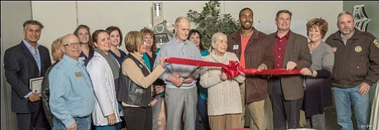 Attending the cutting-the-ribbon ceremony on Friday, Feb. 23, to re-launch the Second Chance Program are, from left, Rich McClish of the YHS Board of Directors; Prescott Valley Town Councilmember Marty Grossman; YHS Medical Services Director Christine Campbell; YHS Spay/Neuter & Wellness Clinic Dr. Katherine Siens; YHS Veterinary Technician and Office Manager Emy Smith; Prescott Mayor Pro Tem Billie Orr; Prescott Valley Chamber Ambassador Debbie Clark; YHS donor Gerald Scheuerman; Prescott Valley Chamber Ambassador Jann Watts; YHS donor Phyllis Scheuerman; Prescott Chamber Board of Directors Andre Carman; Jack Smith, member of the Yavapai County Board of Supervisors; Prescott Valley Chamber CEO Marnie Uhl; and Yavapai County Bagdad-Yarnell Precinct Constable Dennis Dowling. (Gary Gromer/Courtesy)