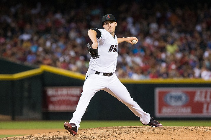 Arizona's Patrick Corbin yielded two runs on seven hits with eight strikeouts and a walk over 5 2/3 innings in his first career opening day start Thursday against the Colorado Rockies.