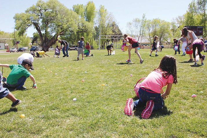 """Kids make their mad dashes for eggs during the 2017 Great Prescott Easter Egg Hunt. This year's event, which starts at 11 a.m. Saturday, March 31, at Mile High Middle School, boasts 20,000 eggs, according to organizer Steve Gottlieb. Entry to the Great Prescott Easter Egg Hunt is $5 for kids and free for parents and will include the Easter Hometown Carnival which has rocket building with the boy scouts, bouncy houses, 500 Easter eggs to color, the """"Easter Bunny"""" from 11:30 to 1:30, pizza and soft drinks, Gottlieb said. The hunt is at 2 p.m. across the entire football field, he said. Mile High Middle School is located at 300 S. Granite St. (Max Efrein/Courier, file)"""