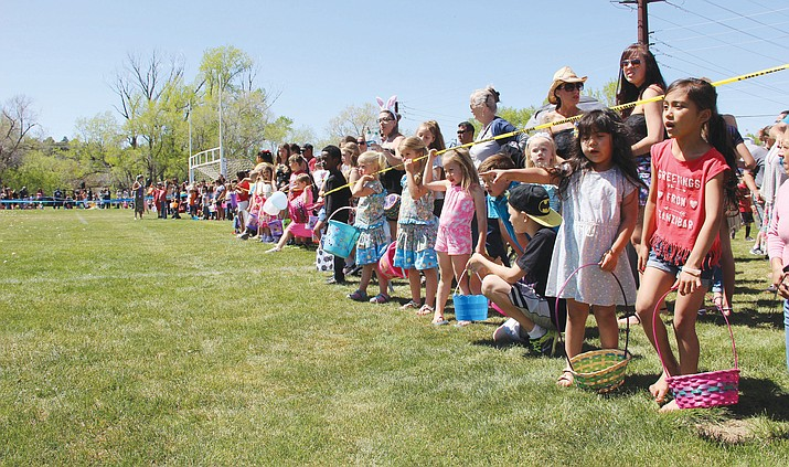 Children wait to rush Mile High Middle School's athletic field in Prescott to collect Easter eggs during the fifth annual Great Prescott Easter Egg Hunt. (Max Efrein/Kudos, file)
