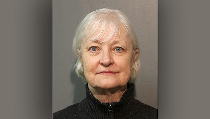 This January 2018, file photo provided by the Chicago Police Department shows Marilyn Hartman. Hartman, who authorities say is a serial stowaway and recently sneaked onto a plane in Chicago, to London, has the local judicial system struggling as to what to do with her. Hartman is due back in court this week and the central question for the judge is what to do about a woman who's repeatedly tried to board commercial flights without a ticket. (Chicago Police Department via AP)