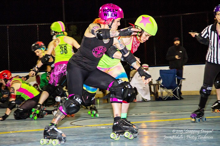 The first competition of the season pits the Whiskey Row-llers against the Atomic Rollergirls of Las Vegas in the Northern Arizona Roller Derby's first year as an official member of the Women's Flat Track Derby Association.