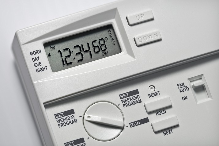The use of a programmable thermostat can reduce energy use between 5 and 30 percent. (Stock photo)