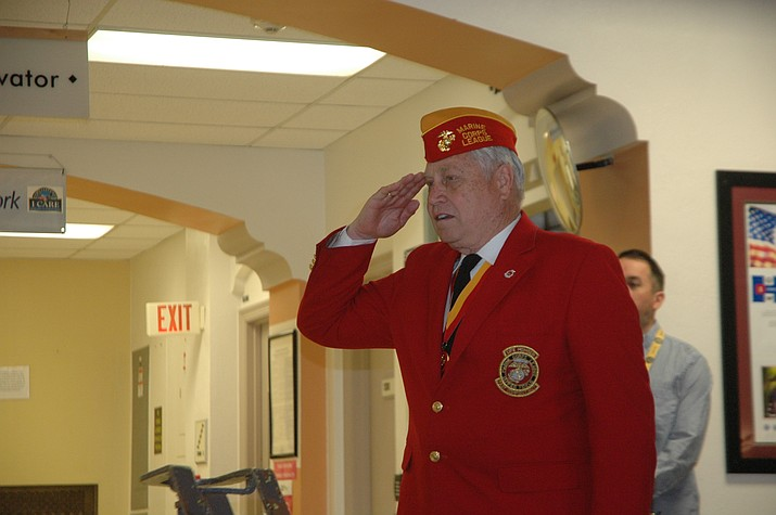Vietnam veteran Bob Wallace led the Pledge of Allegiance at the VA's 50th Anniversary Vietnam Veteran Recognition Thursday, March 29 in the hospital lobby. It was a chance to say thank you to his comrades, Wallace said. (Jason Wheeler/Courier)