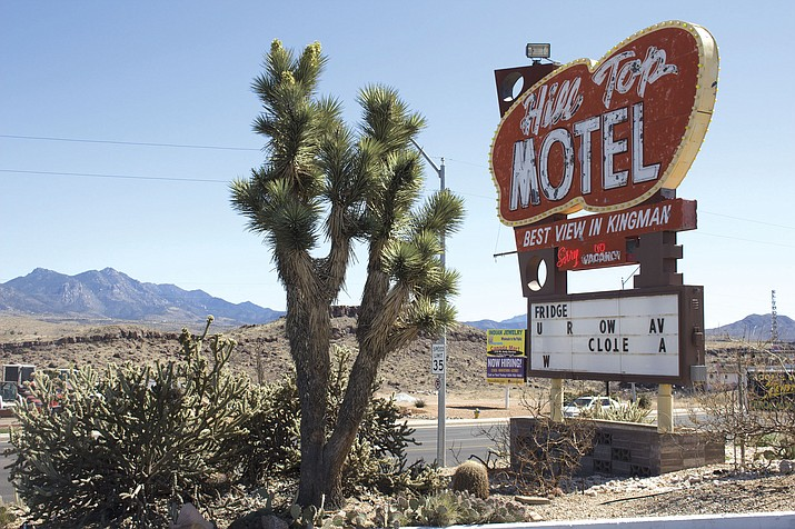 The neon Hill Top Motel sign is one of the nostalgic features of the motel that was popular among motorists on Route 66. Mohave State Bank foreclosed on the motel in December.