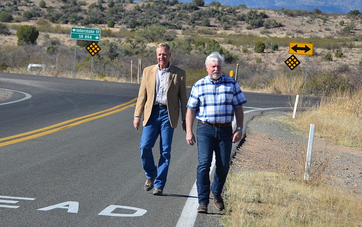 Supervisors Thomas Thurman and Randy Garrison meet on Beaverhead Flats Road and East Cornville Road where they want to extend Beaver Flats Road across the Verde River to SR260 in Camp Verde or Cottonwood. (pictured behind them in photo). VVN/Vyto Starinskas