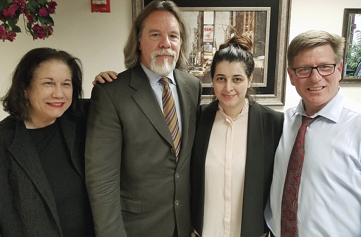 In this Friday, March 30, 2018 photo released by Susan Clary, Noor Salman, second from right, and her attorneys pose for a photo after Salman was acquitted of lying to the FBI and helping her husband attack the Pulse nightclub in Orlando, Fla. The attorneys, Linda Moreno, Fritz Scheller, Charles Swift pose with Salman from left. (Susan Clary)