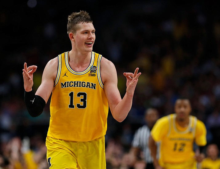 Michigan's Moritz Wagner (13) reacts after scoring a 3-point shot against Loyola-Chicago during the second half Saturday, March 31, 2018, in San Antonio. (Charlie Neibergall/AP)