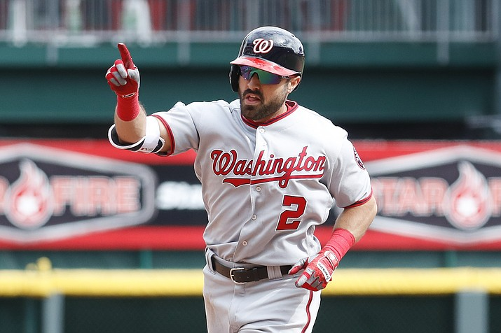Washington Nationals' Adam Eaton runs the bases after hitting a solo home run off Cincinnati Reds relief pitcher Austin Brice in the seventh inning Saturday, March 31, 2018, in Cincinnati. (John Minchillo/AP)