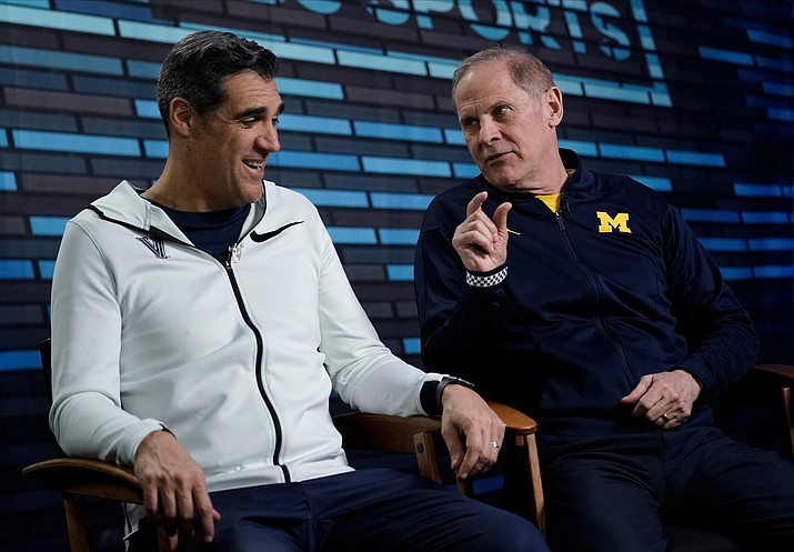 "Villanova head coach Jay Wright, left, and Michigan head coach John Beilein, answer questions during an interview for CBS Sports Network's ""We Need to Talk"" show before the championship game of the Final Four NCAA college basketball tournament Sunday, April 1, 2018, in San Antonio. (David J. Phillip/AP)"