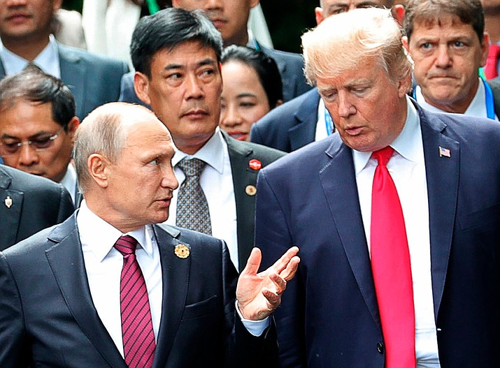 In this Nov. 11, 2017, file photo, President Donald Trump, right, and Russia President Vladimir Putin talk during the family photo session at the APEC Summit in Danang. The Trump administration is opening the door to a potential White House meeting between Trump and Putin. It would be the first time Putin has been at the White House in more than a decade and come at a time of rising tensions between the two global powers. (Mikhail Klimentyev, Sputnik, Kremlin Pool Photo)