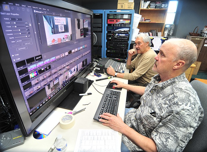 Director Dave Barrett and sound engineer Bill Topping go over some final details before the annual Kiwanis Auction Thursday, March 29, 2018. The 2019 auction is March 25-29 and April 1-5. (Les Stukenberg/Courier, file)